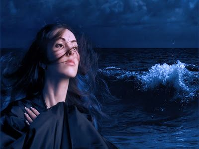 moon in pisces woman looking emotional and lost at sea
