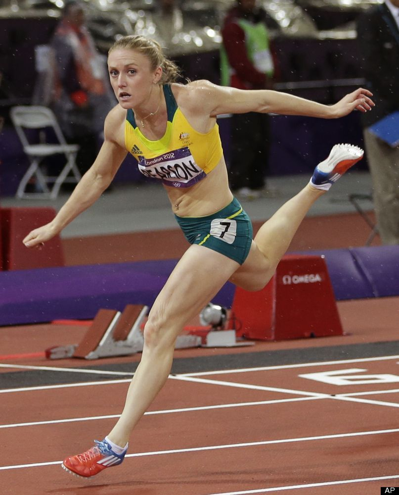 Australia's Sally Pearson reacts as she crosses the finish line to win gold  in the women's hurdles final during the athletics in the Olympic Stadium at  the ...