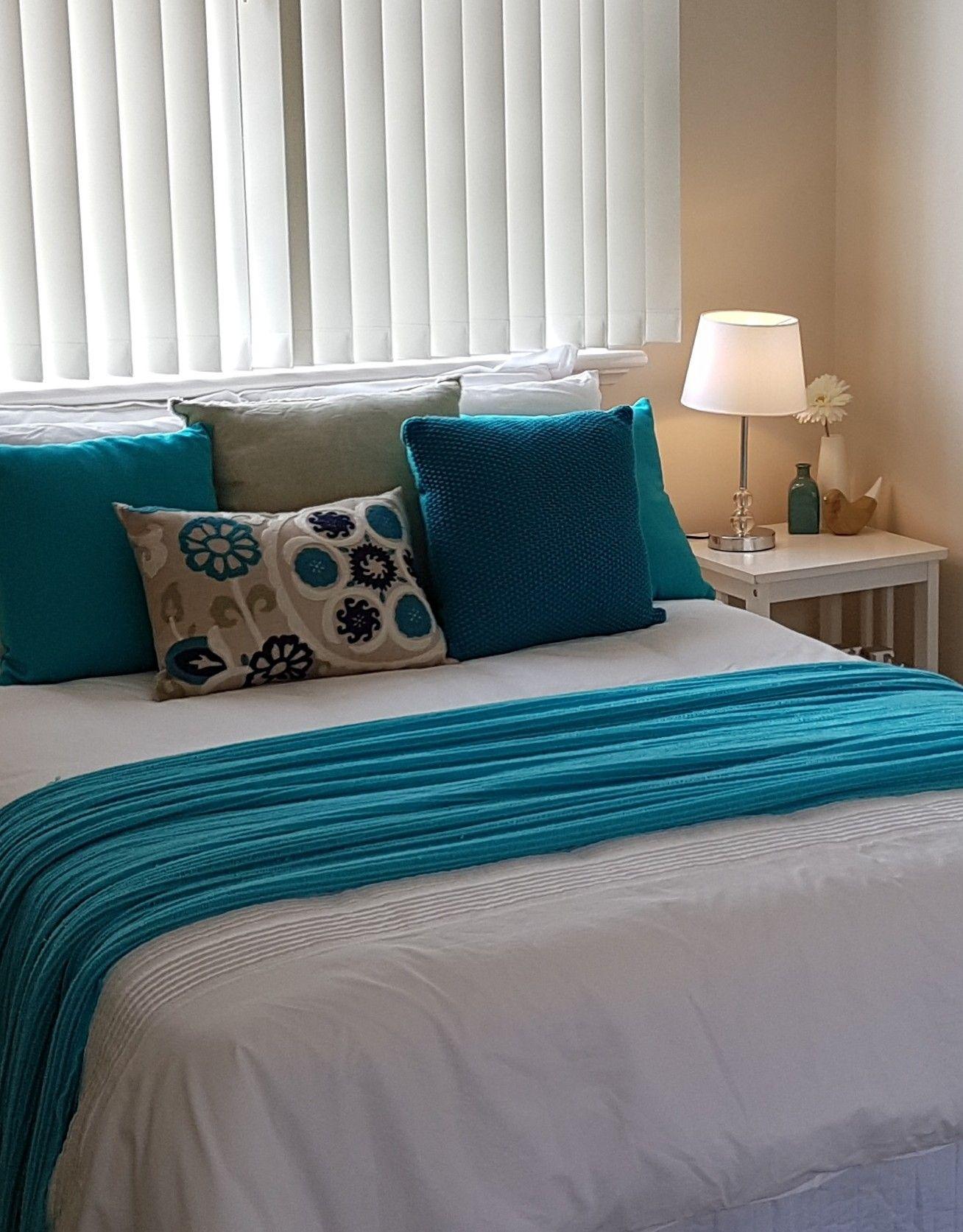 Master bedroom teal on white. Home staging, Master