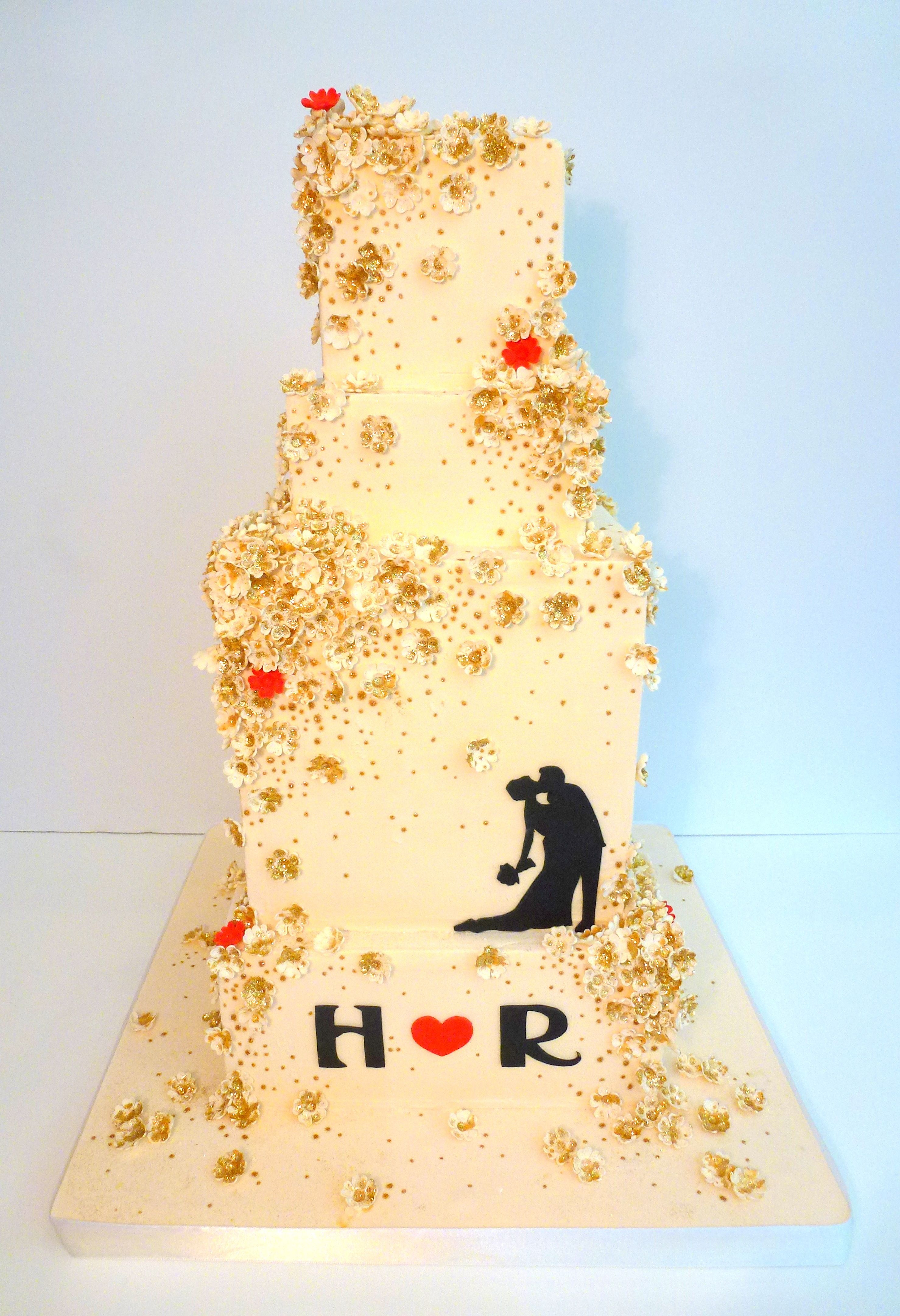 Glitter is always a good idea glitter and flowers wedding cake