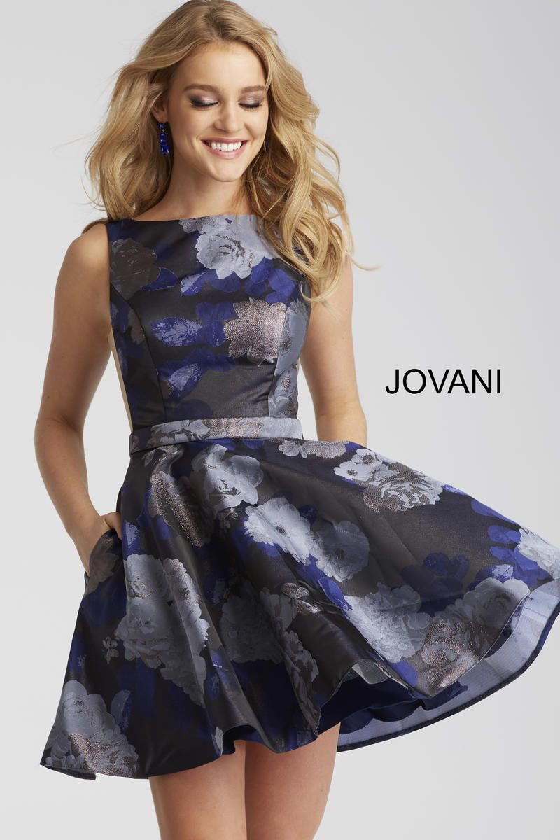 9710ca97b5 Style 52283 from Jovani is a floral print fit and flare short party dress  with a sleeveless deep V back bodice with sheer sides.