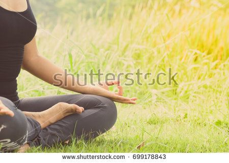 healthy woman practicing yoga on the outdoor public park