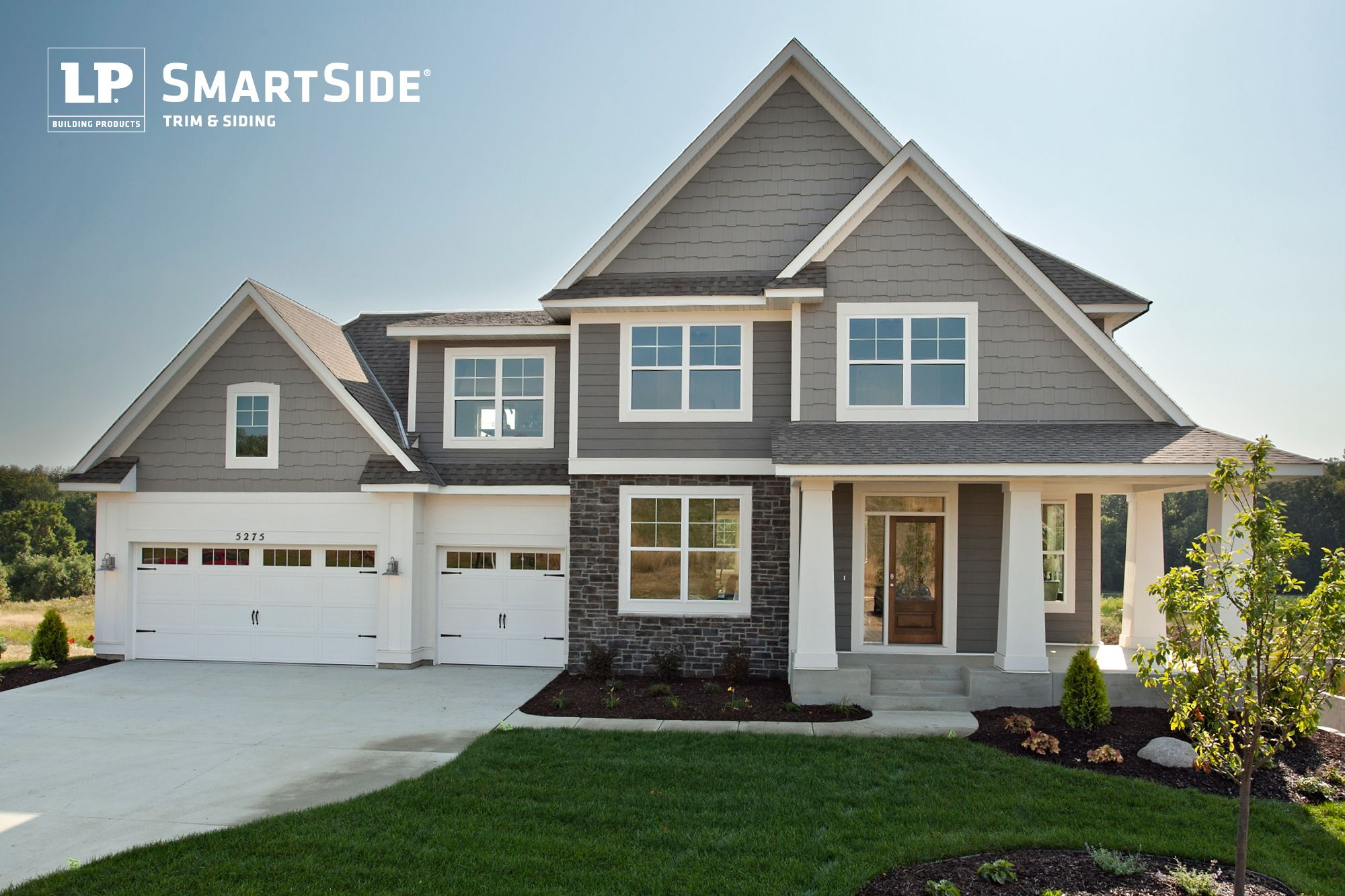 An inviting home featuring lp smartside trim and siding for Homes with wood siding
