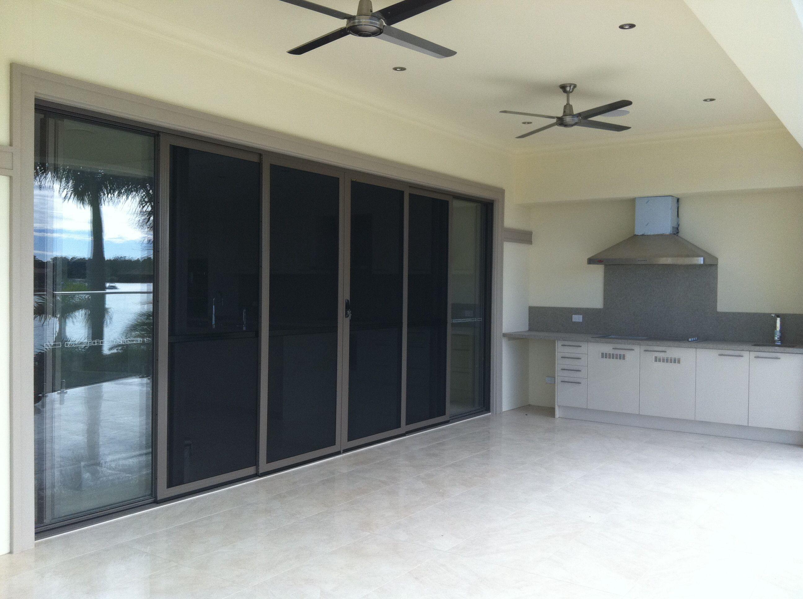 Stacker Door From Rumpus To Alfresco With Bbq Built In And Fans Stacker Doors Aluminium Sliding Doors Patio Projects