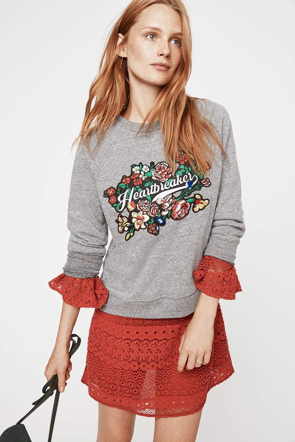 "Heartbreaker Patch Sweatshirt - #Humblebrag. Our sweatshirts are so cozy. The best part—they're put together enough that you can wear them pretty much everywhere. And this one features a colorful ""Heartbreaker"" patch for a little cheekiness."