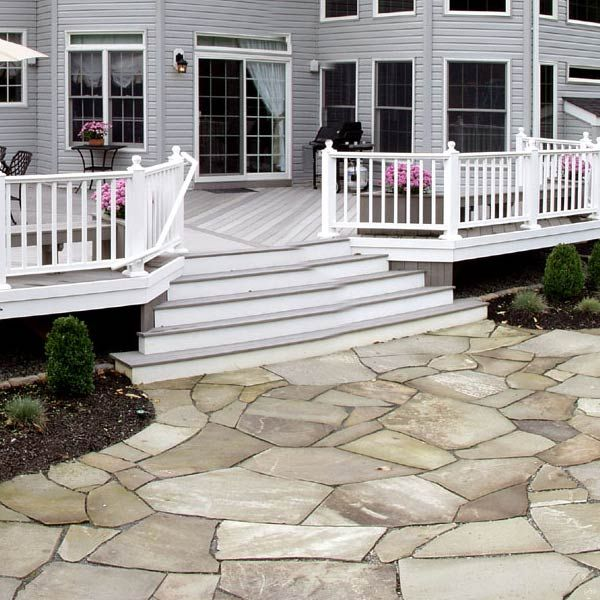The Neutral Grays Of This Flagstone Patio Complement The