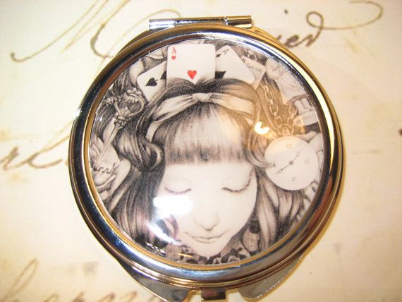 Compact Mirror with Alice in Wonderland by RubysRibbonsandBows on Etsy.