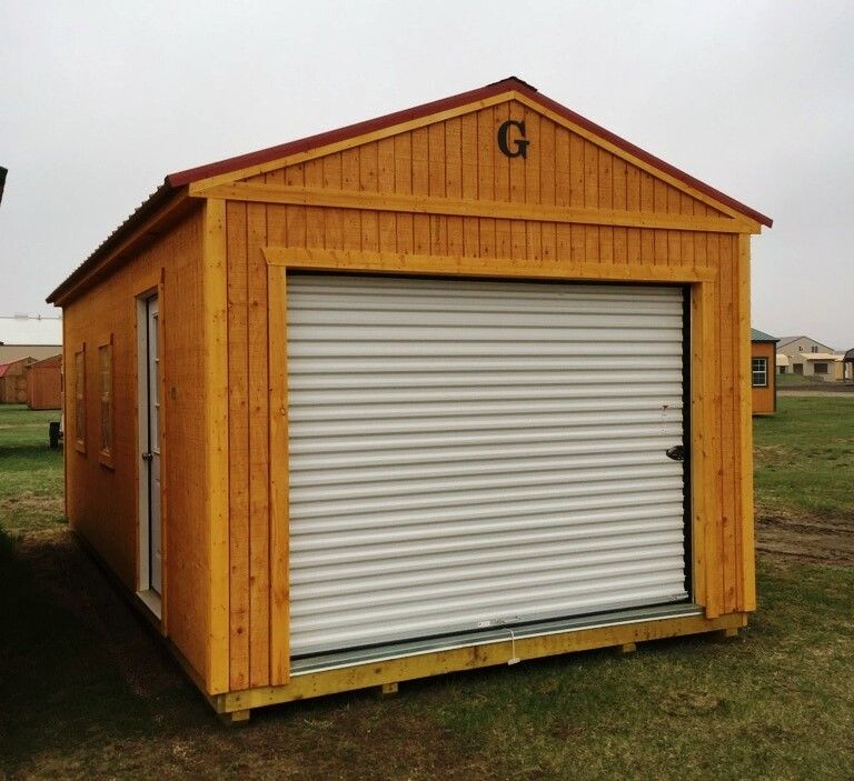 12x24 Garage Red Metal Roof 9 Roll Up Door And 36 Service Door 2 Windows 3 4 Floor Upgrade Honeygold Staine Portable Sheds Portable Buildings Shed
