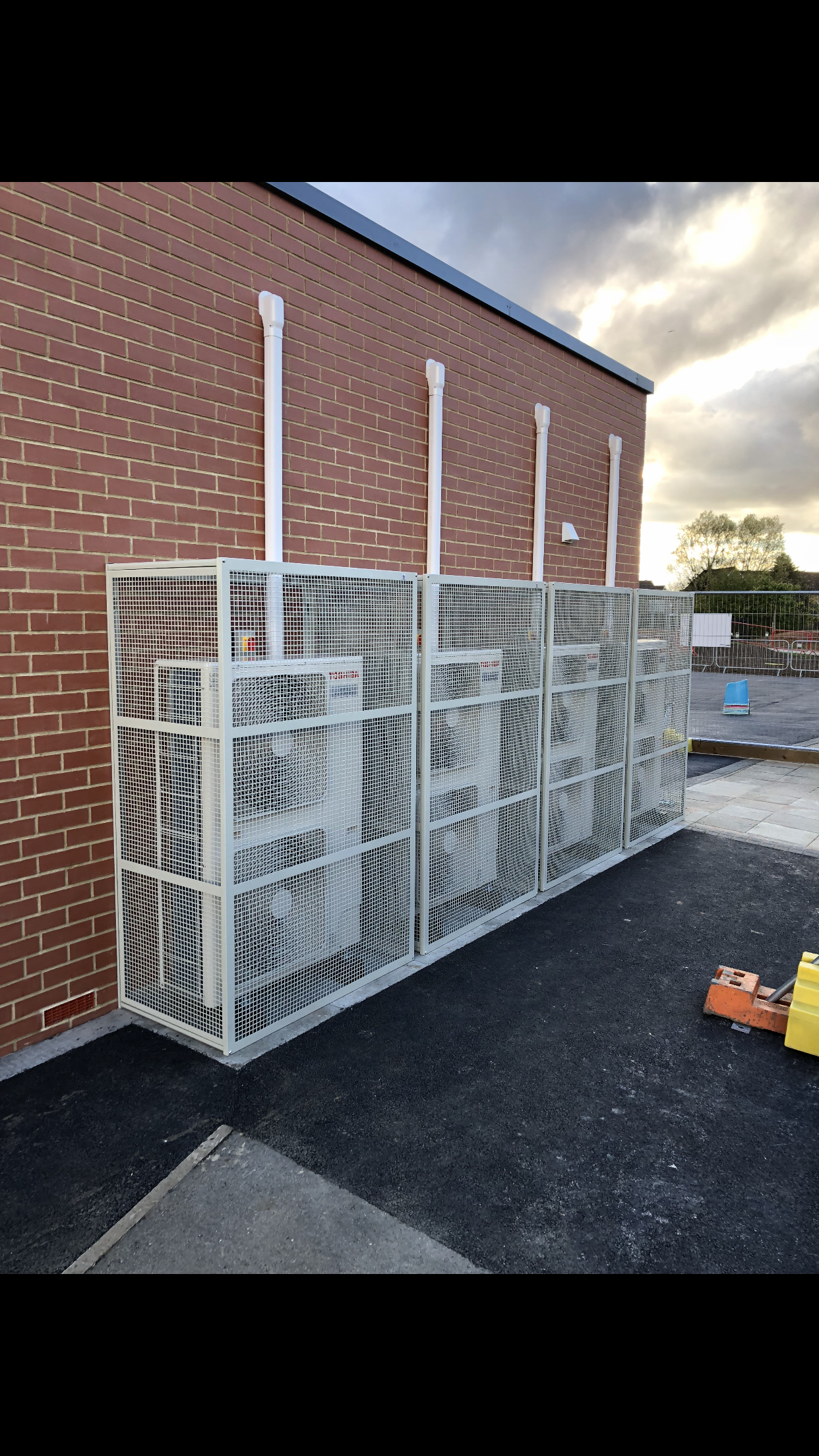 A Row Of Toshiba Air Conditioning Condensing Units Supplying