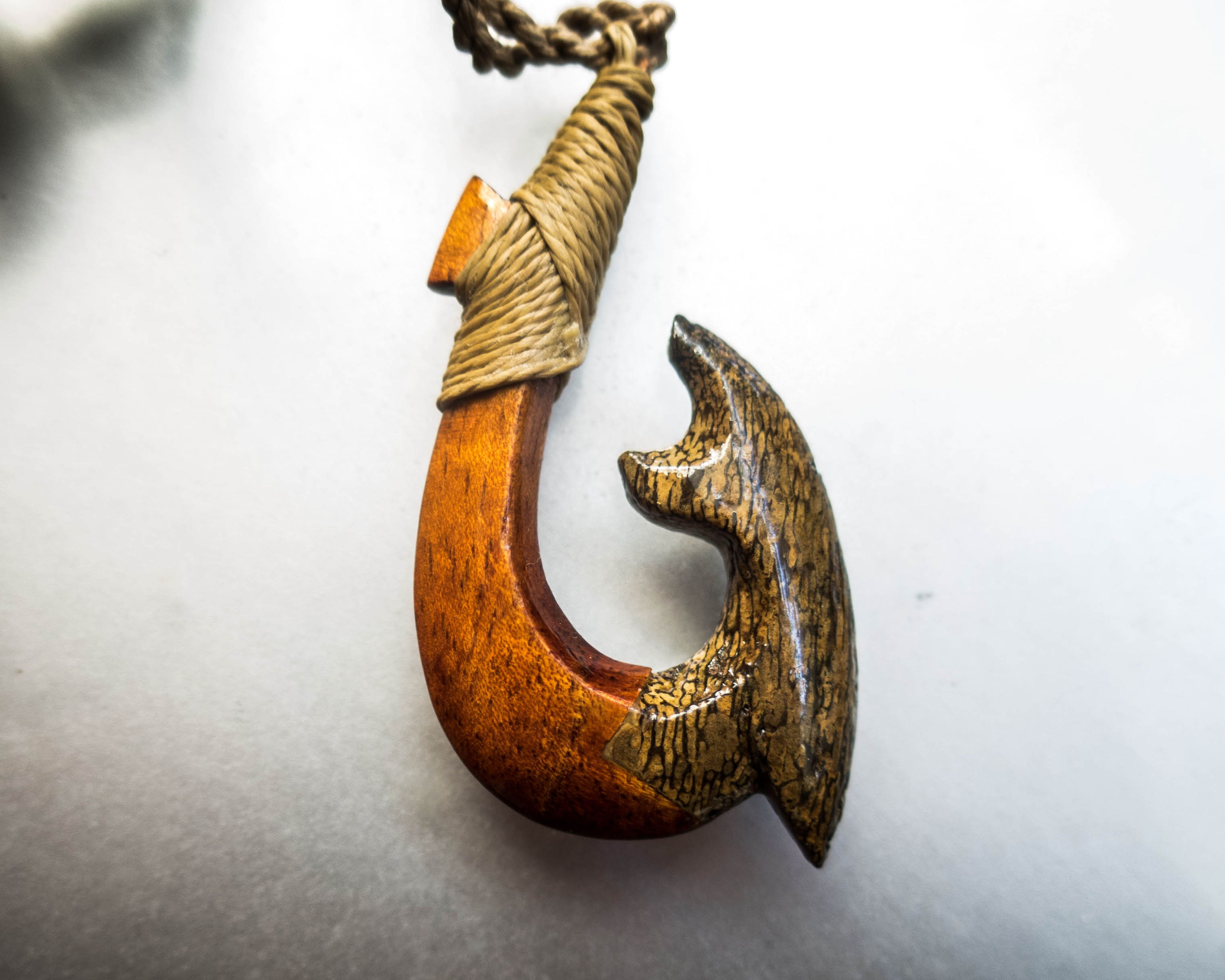 This exotic fish hook is made of koa wood and whale bone