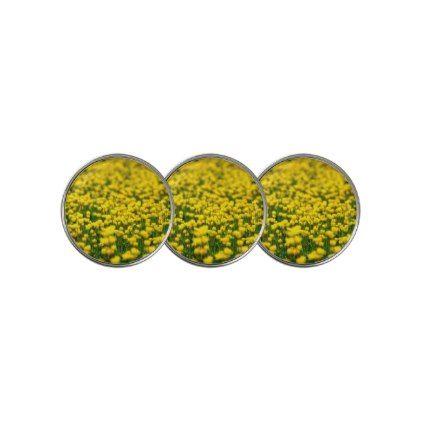 Small yellow wild flowers in the green field golf ball marker wild small yellow wild flowers in the green field golf ball marker wild flowers and flowers mightylinksfo