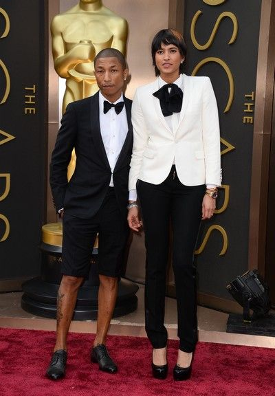 Credit: Jordan Strauss/Jordan Strauss/Invision/AP Pharrell Williams and Helen Lasichanh: 'Loving the studied awkwardness of them together with their mix-and-match tux actions'