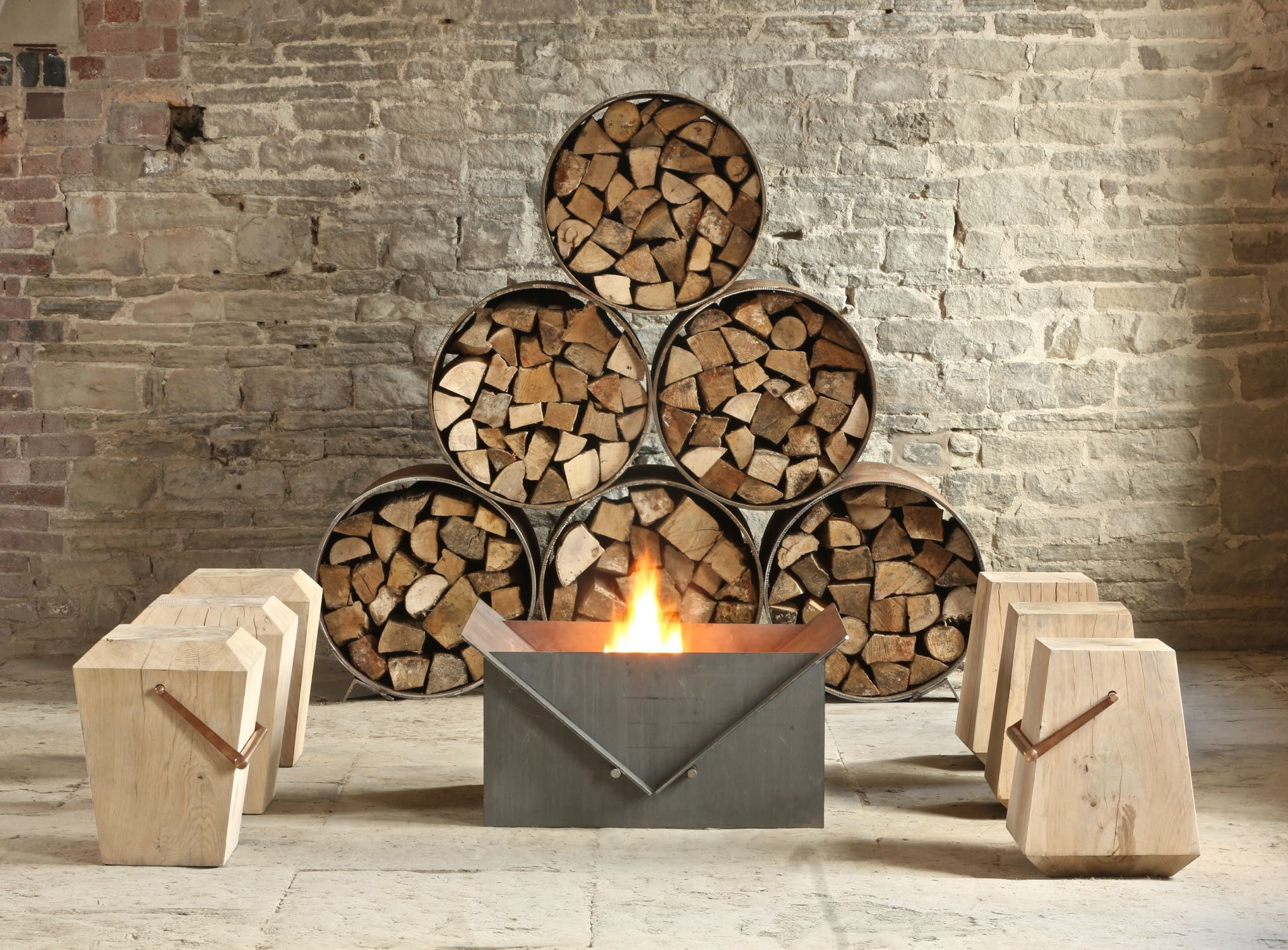 Steel log store and firepit. Solid oak stools.