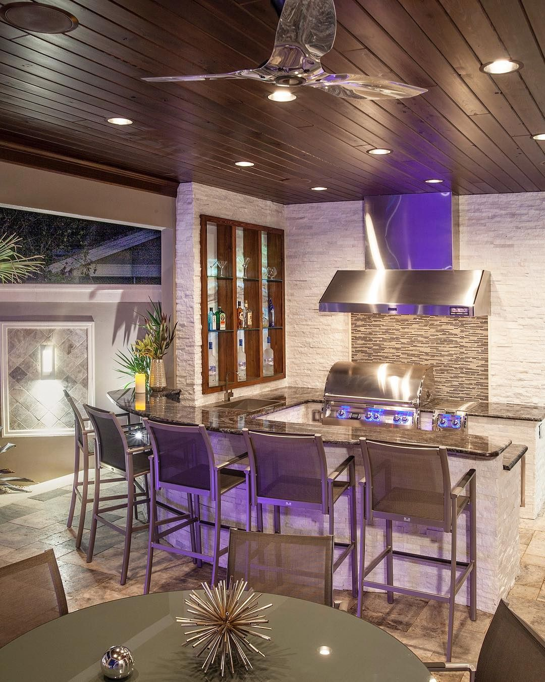 Ryan Hughes Design Build On Instagram Outdoor Kitchen With A Modern Vibe Featuring A Backlit Onyx Bar Shelves An Outdoor Kitchen Modern Vibe Building Design