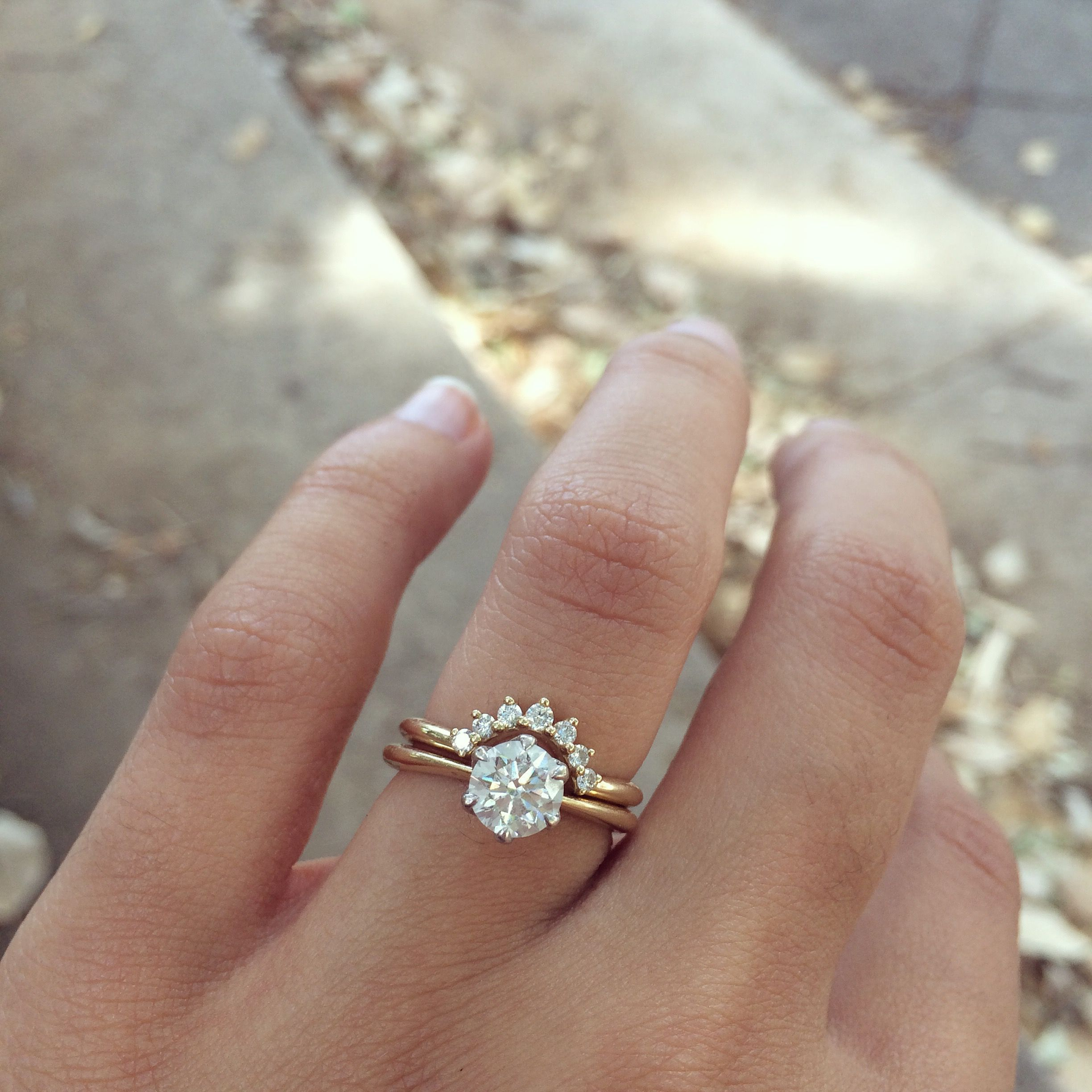 Curved band with solitaire round engagement ring in 2019