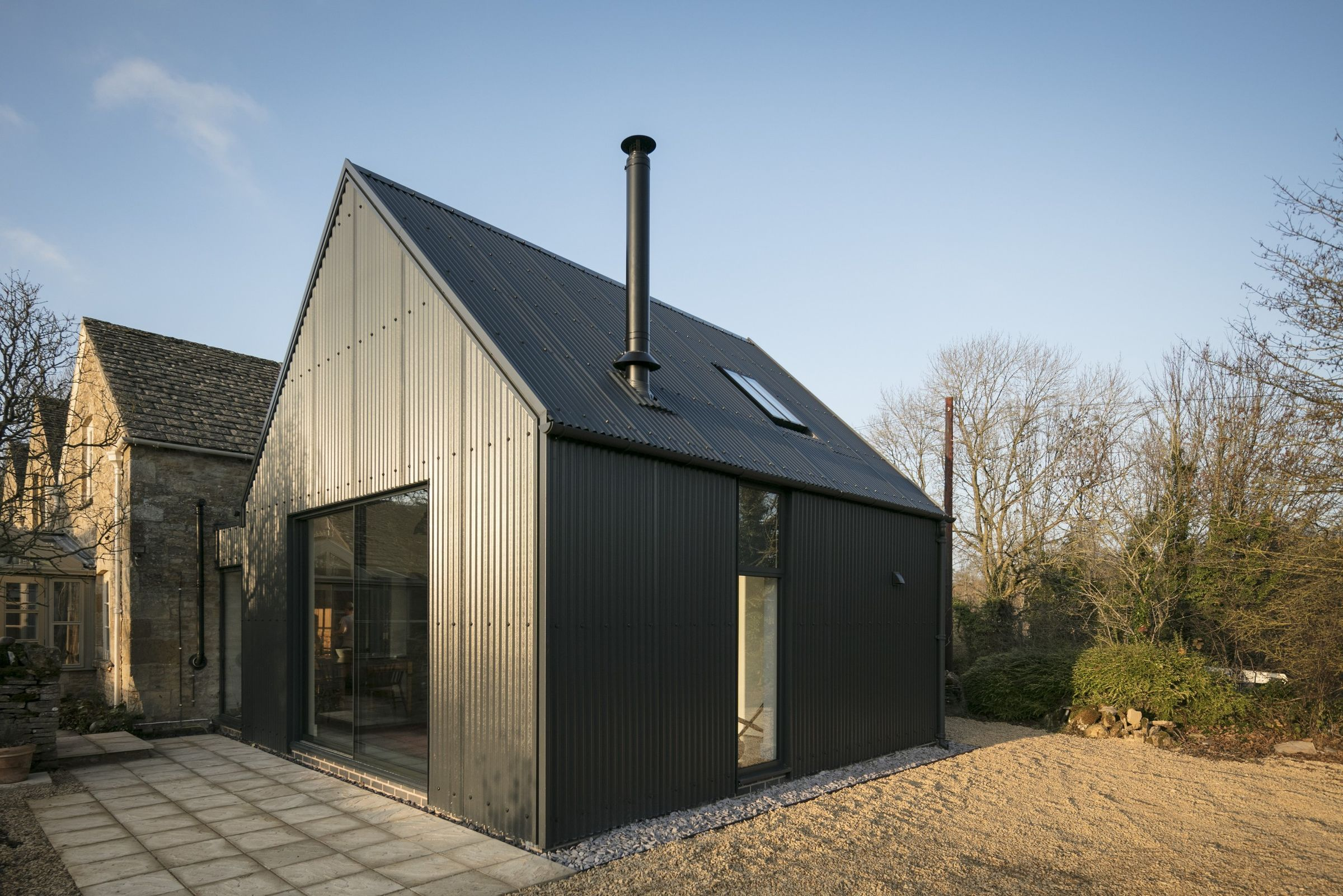 Corrugated Metal Extension Eastabrook Architects Archello Corrugated Metal Metal Cladding Stone Cottages