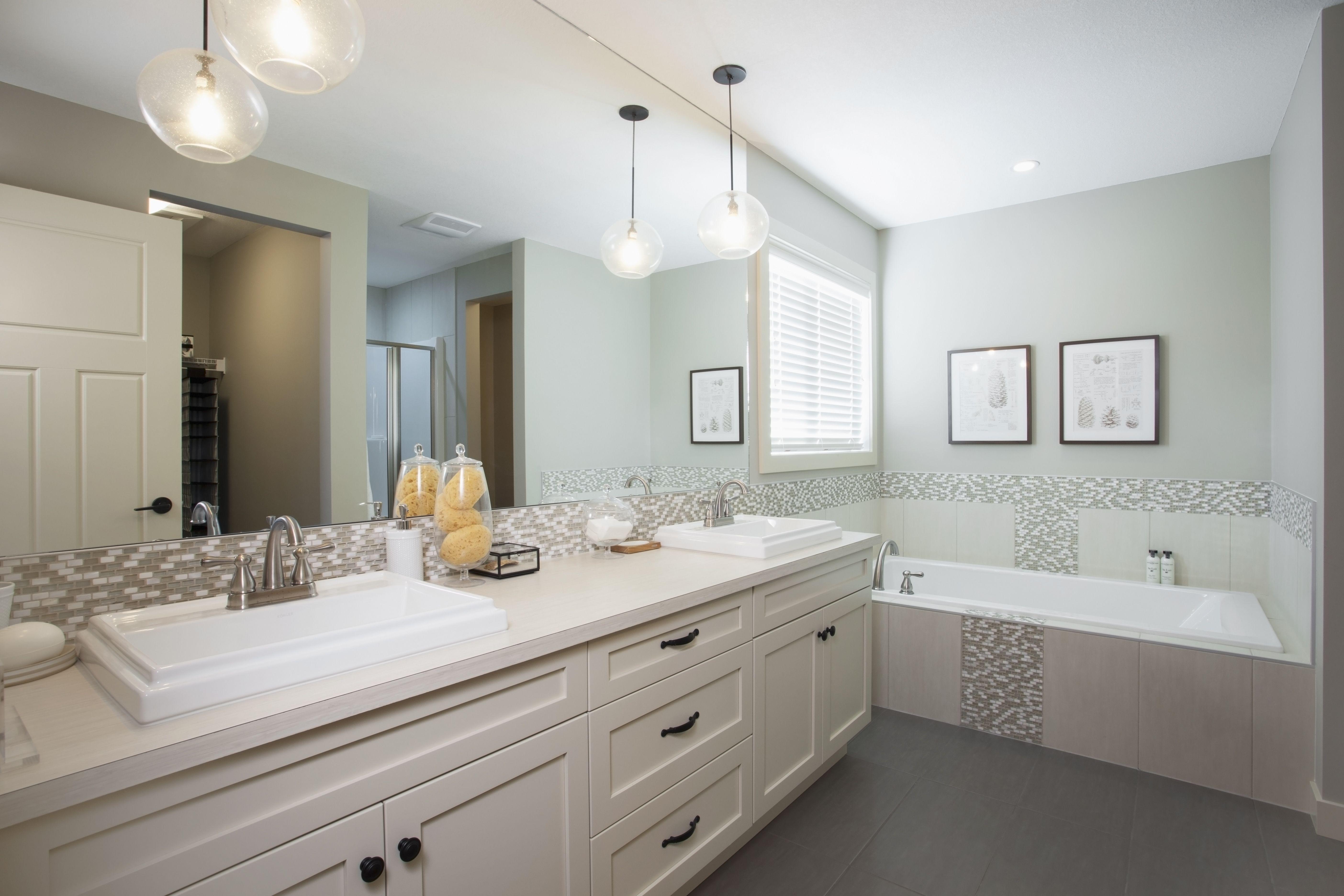 Bathroom Pendant Lights In Front Of Builder Mirror Backsplash Tile
