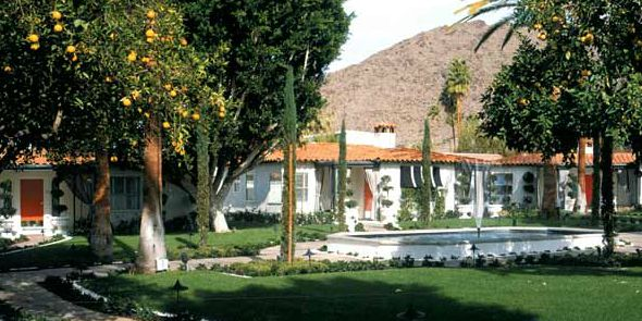 California. Spanish influence. Tile Roof. White Stucco. Orange Door. Orange Trees.