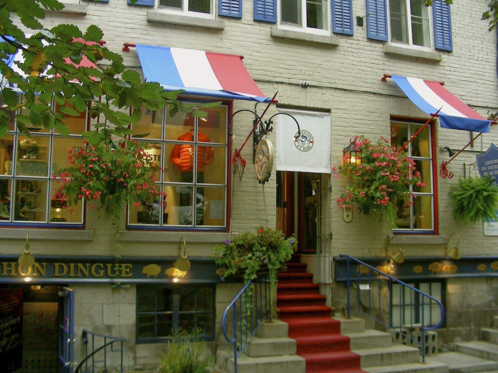 Great example of store front curb appeal using a good touch of ...