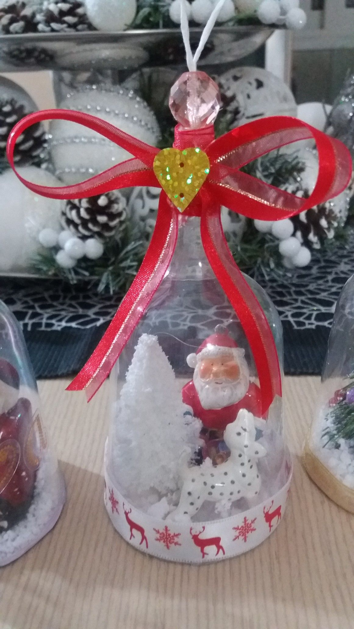 DIY Christmas tree ornament from plastic wine glass. Santa Claus with his snowy Christmas tree and his dog. Beautiful Christmas DIY for kids