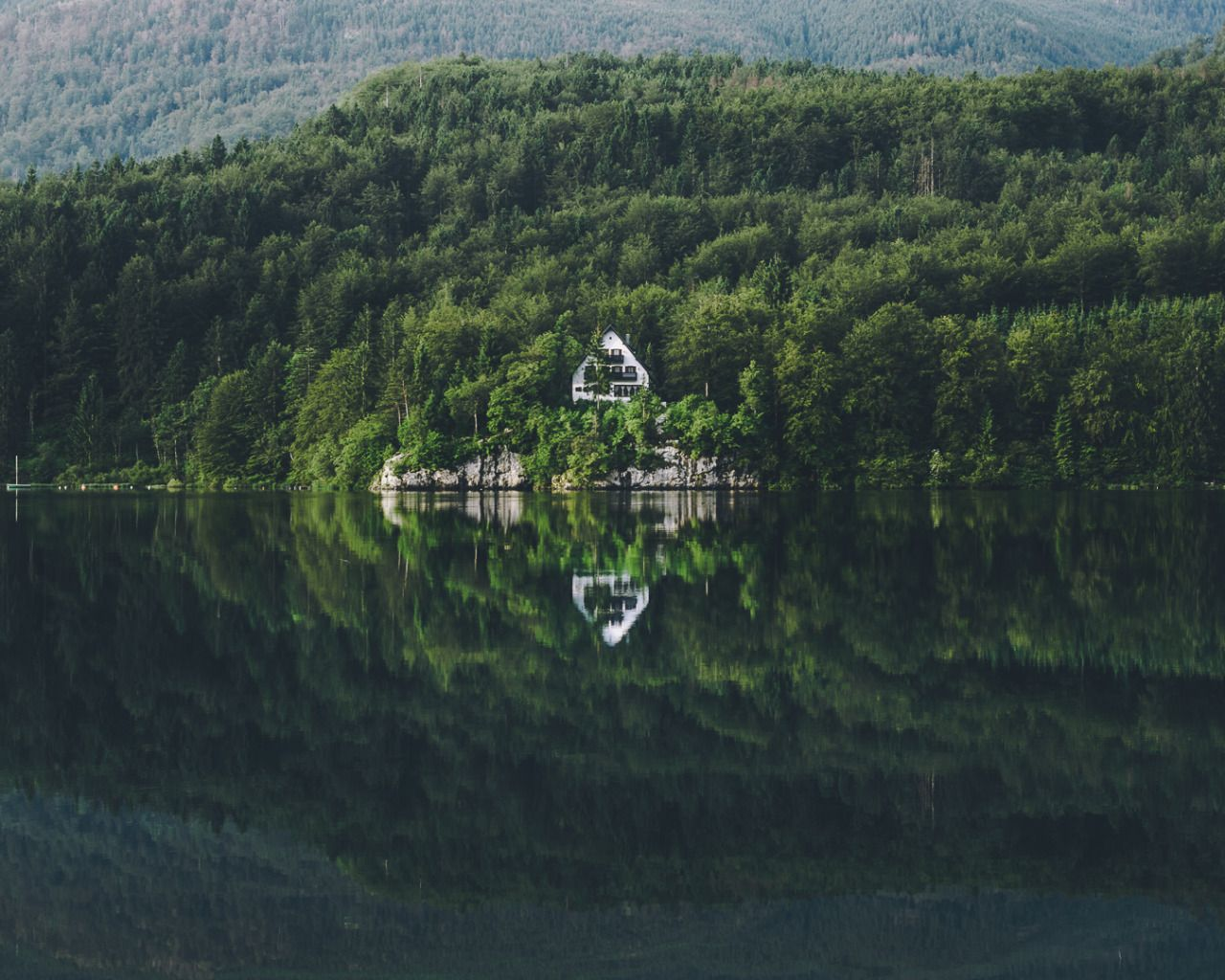 merlinkafka:  Nestled in the forest on the banks of Lake Bohinj I found this little retreat.