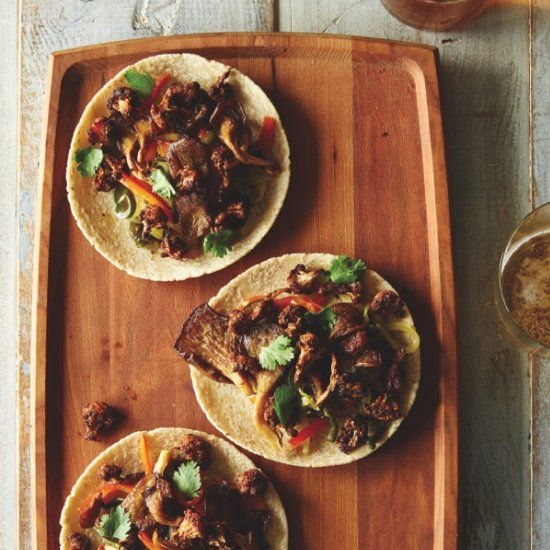 Hearty, chewy, and satisfying spice-rubbed roasted cauliflower and oyster mushroom tacos from the book FOOD52 VEGAN. Vegan + GF!