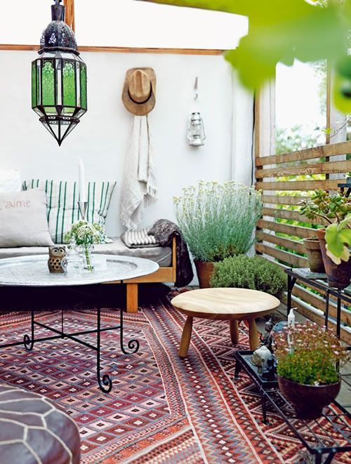Ethnic Modern Home Decoration. Outdoor Space With Rug, Tables, Lantern,  Greenery.