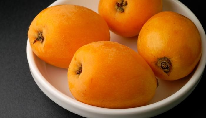 Fresh from the tree, the loquat is juicy, sweet, and bursting with juice and flavor.