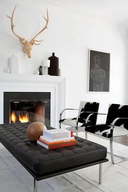 Black and white living room Love the cowhide chairs and faux wooden