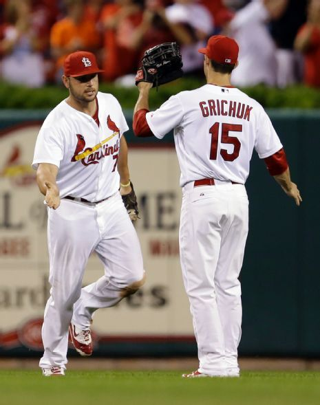 Matt Holliday and Randal Grichuk celebrate following the Cardinals' 2-1 victory over the Cincinnati Reds. 9-19-14