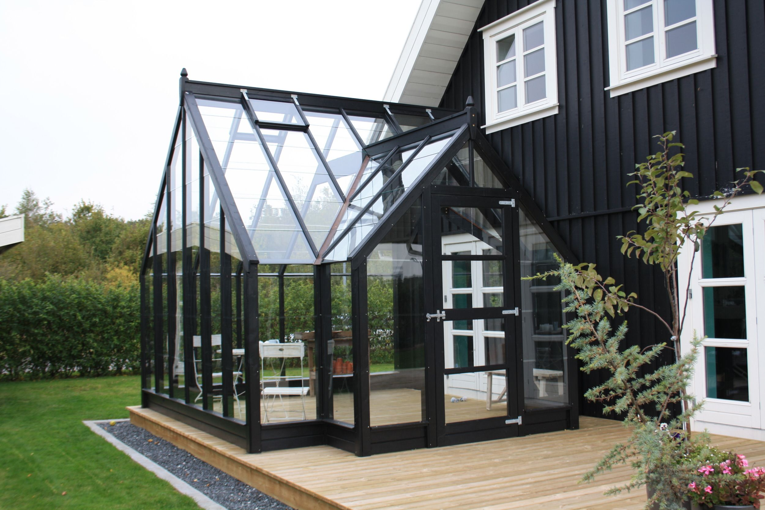 Greenhouse built as extension to house on deck outdoor for Garden house extension