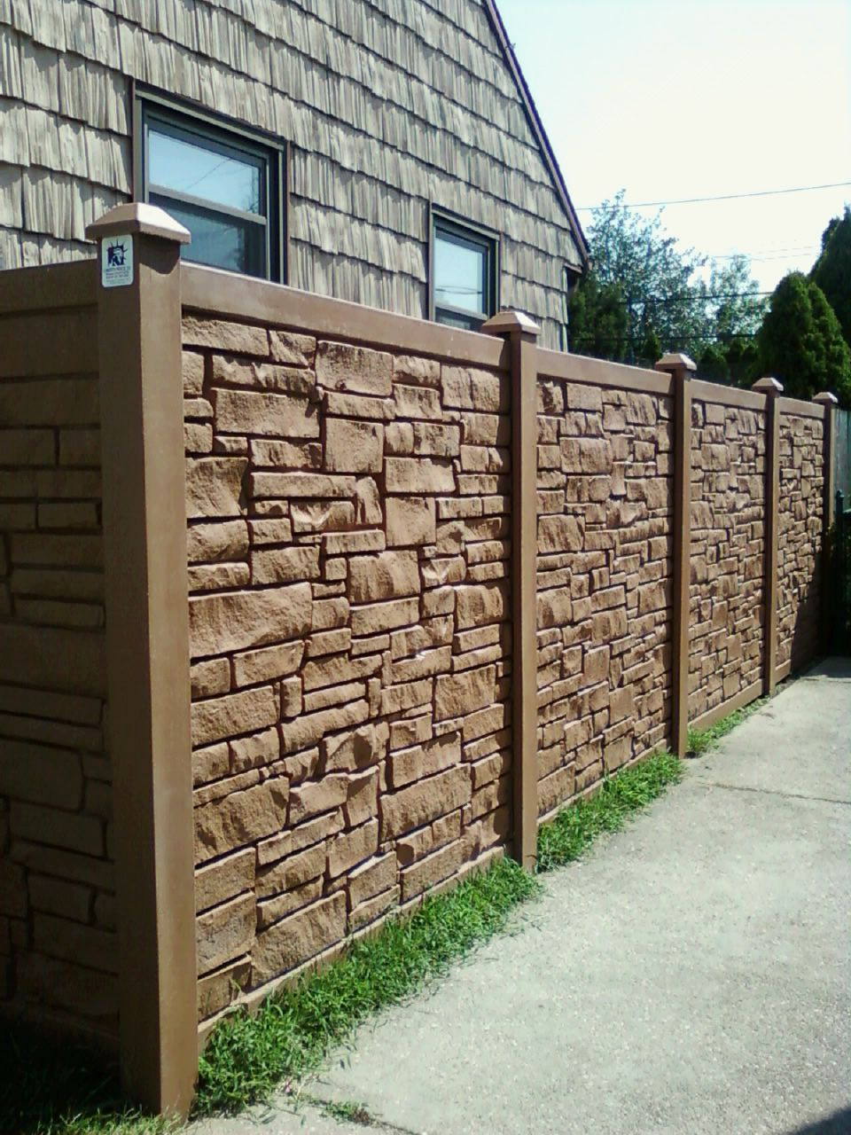 "72"" desert redwood vinyl stone fence installed by Liberty"