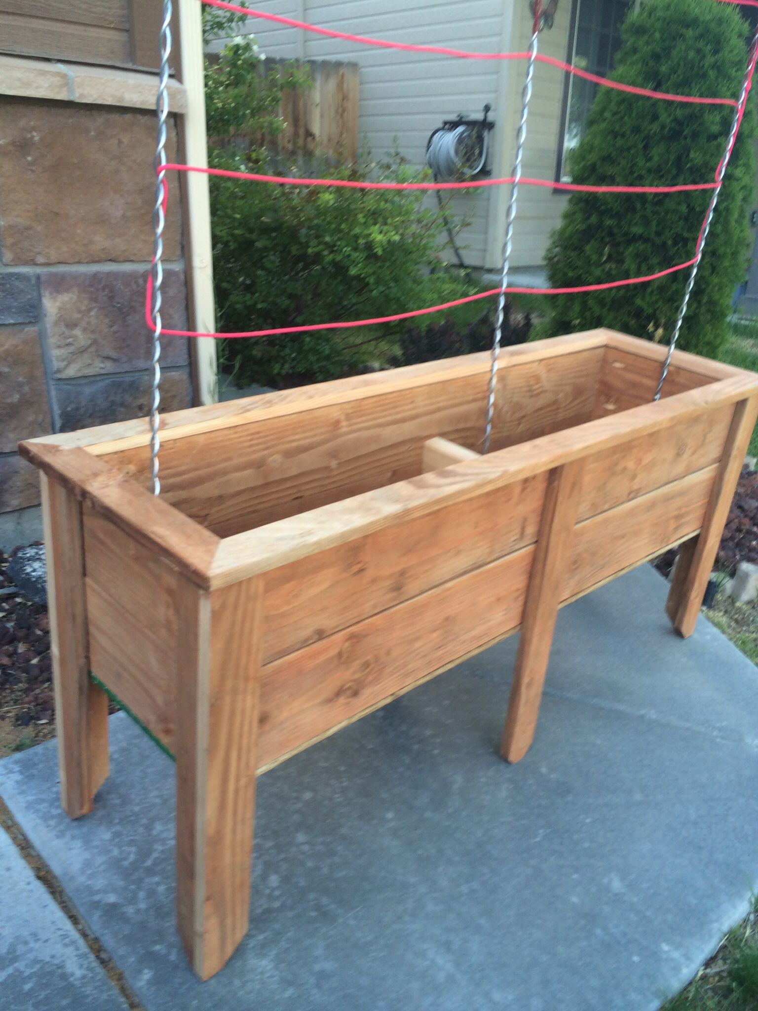 Planter Box Made Out Of 5 Stained Fence Pickets Using A Table Saw, A Couple