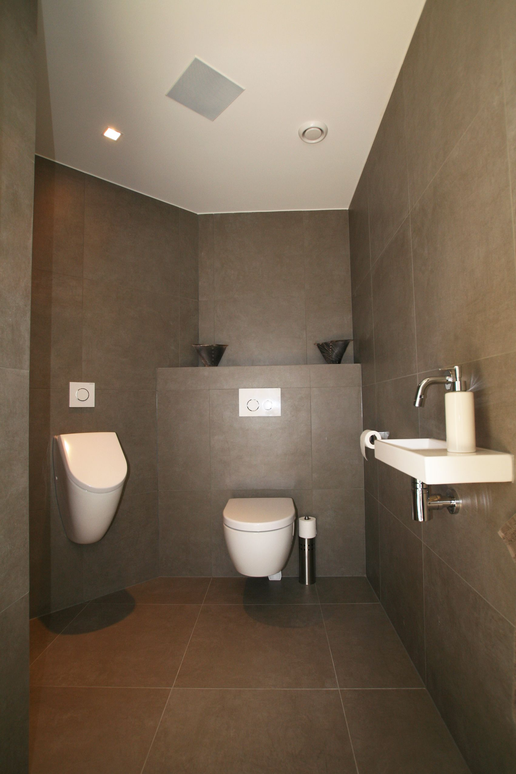 wall hung toilet and urinal and i d also place a bidet and bidet