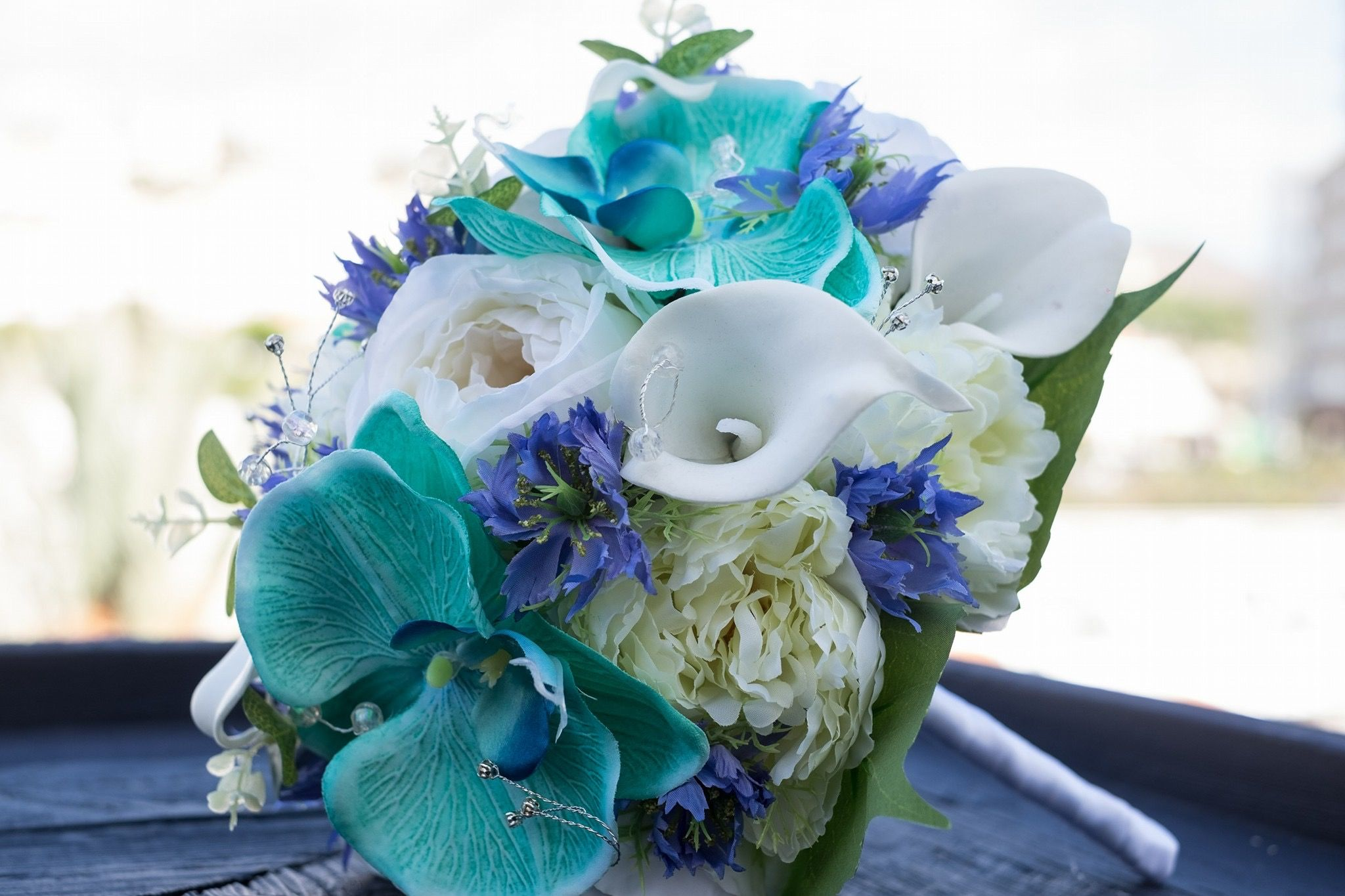 Bridal bouquet made with everlasting flowers phalaenopsis orchids bridal bouquet made with everlasting flowers phalaenopsis orchids calla lilies nigella and roses izmirmasajfo
