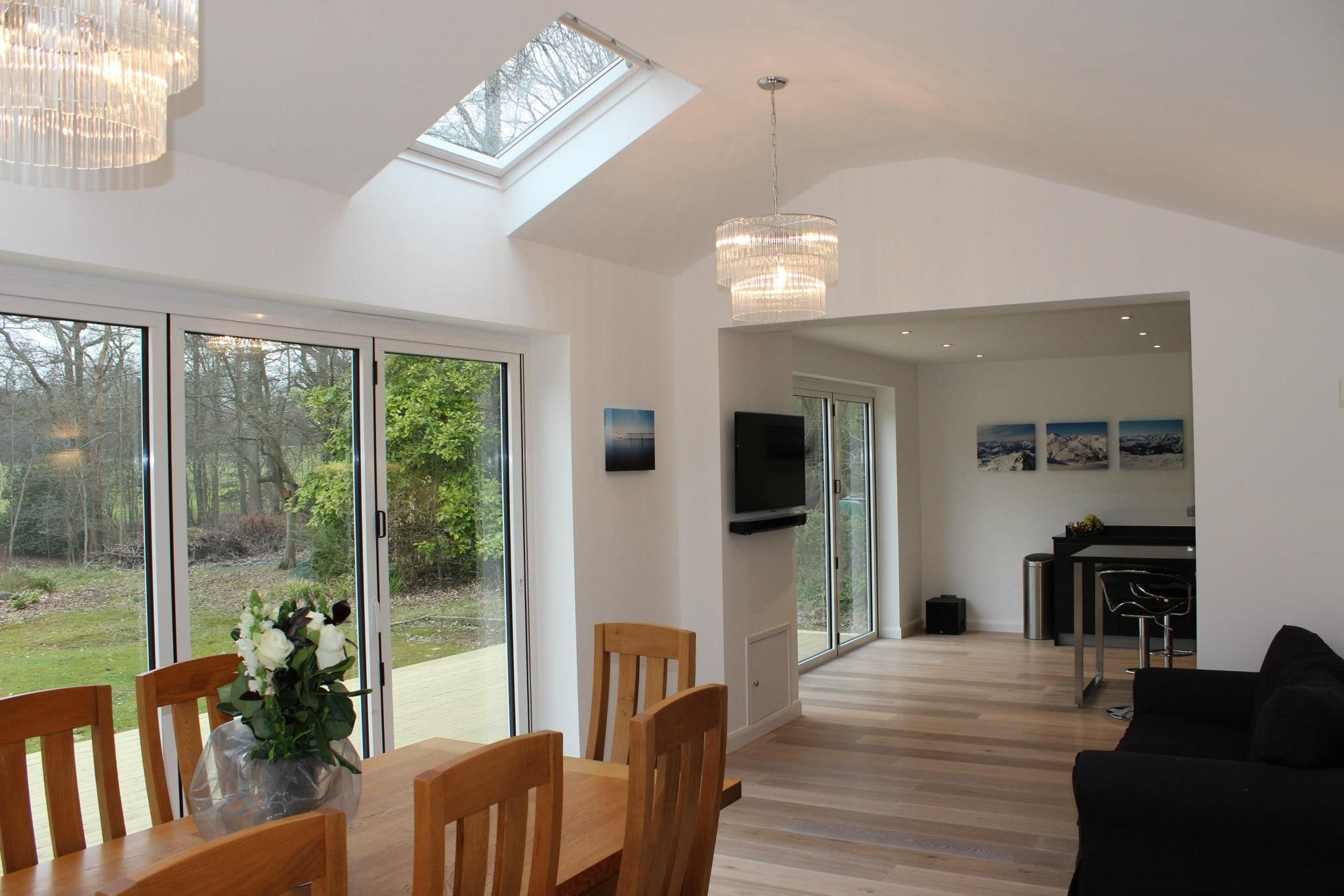 Kitchen With Vaulted Ceilings 2 X Sets Of Bi Fold Doors Onto Decked Area With Skylights And