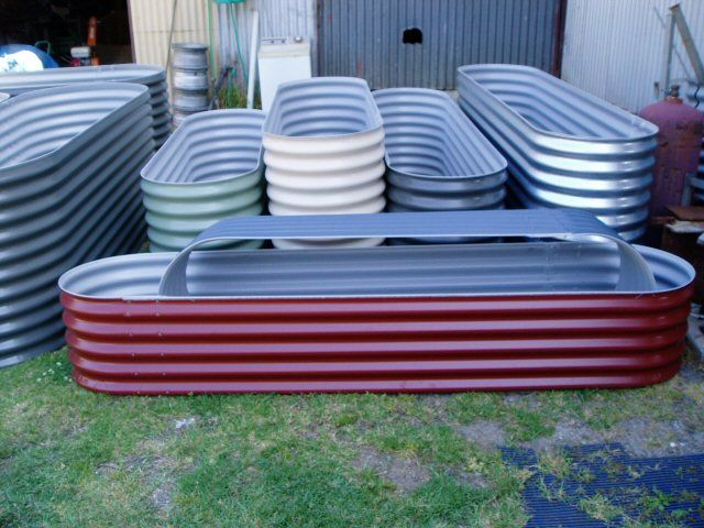 Stock Water Tubs As Raised Beds Tractor Supply Here I Come Garden Beds Mid Century Modern Landscaping Backyard Makeover