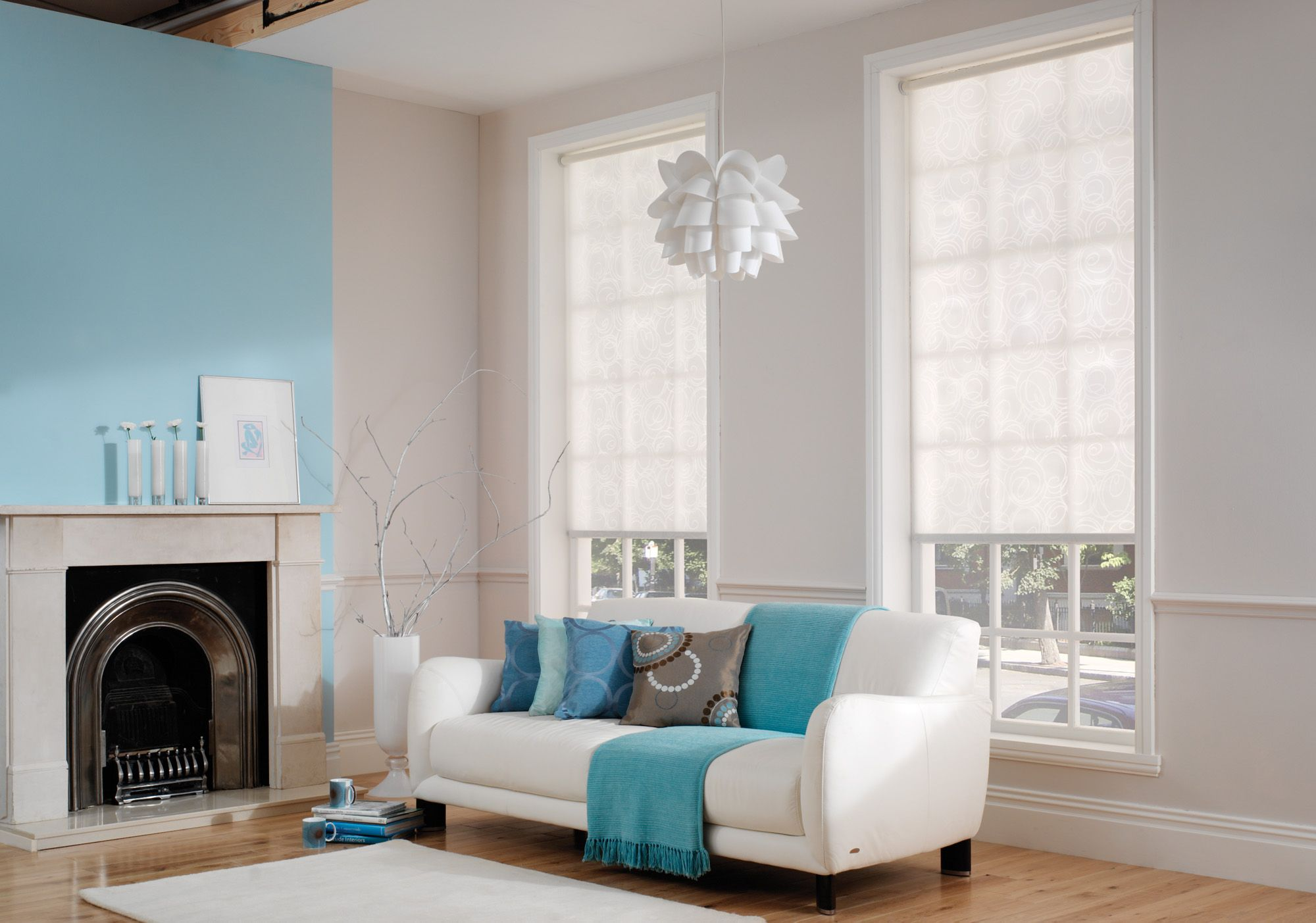 Swirling Patterned Sheer White Roller Blinds In A