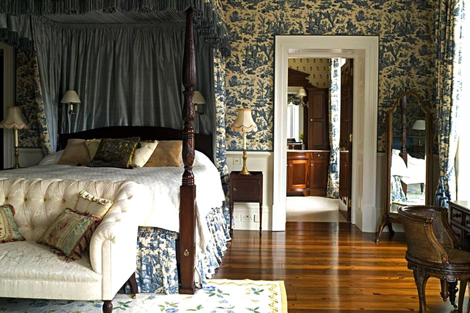 A guest bedroom in the Scotland house is bedecked in blue Toile de Jouy fabrics and wallpaper.