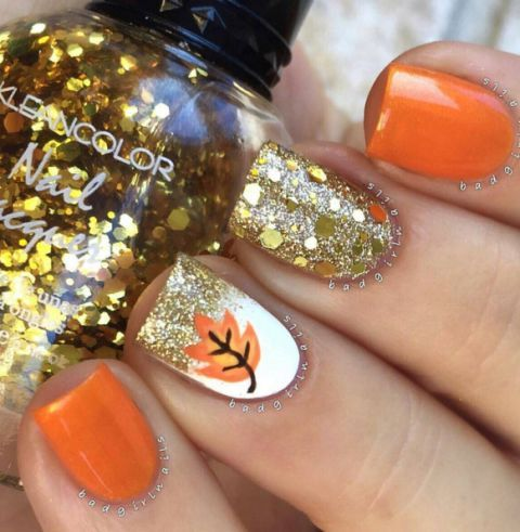 Step up your gold glitter mani by painting on a lovely little orange… - 35 Nail Designs That Are So Perfect For Fall Gold Glitter, Gold