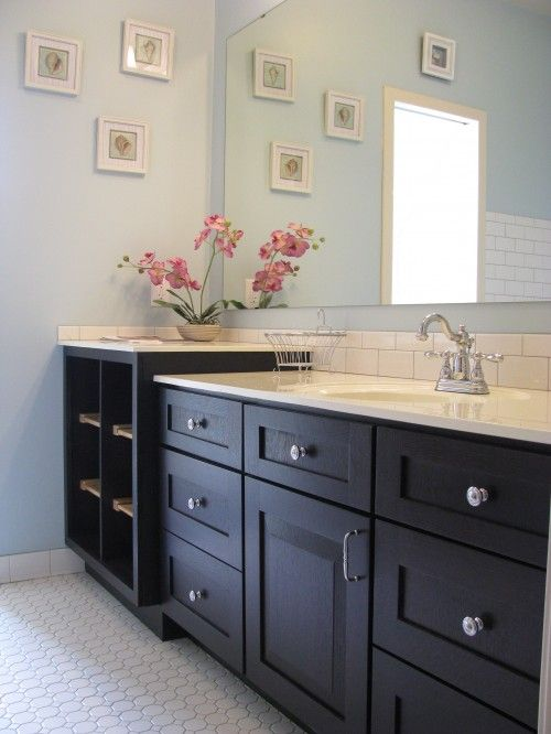 light blue bathroom with white countertop subway tile and