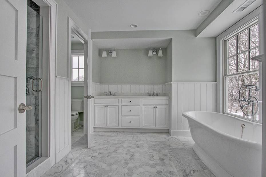 Cottage Master Bathroom With Specialty Door, Wall Sconce