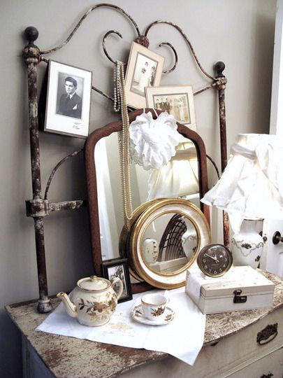 looks like an iron/wire twin bed headboard as a vanity back...pretty cool