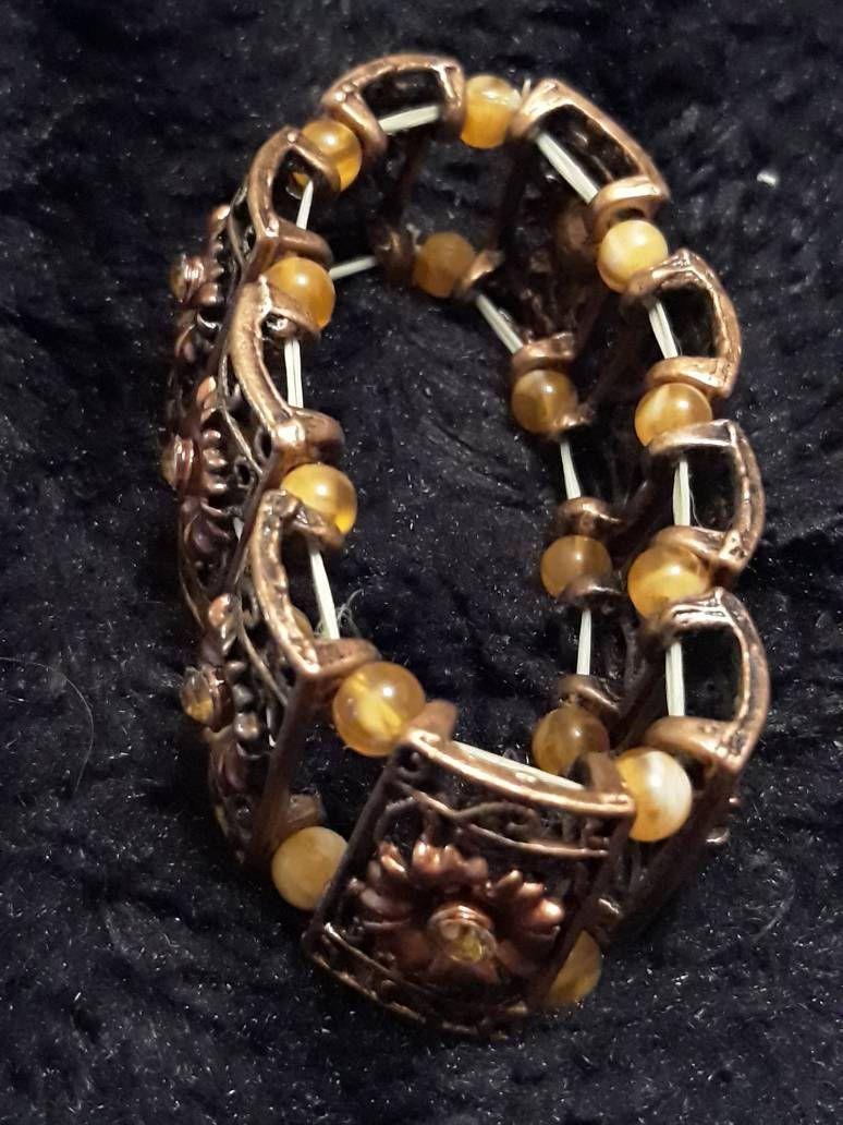 Vintage copper panel expanding bracelet with floral design that