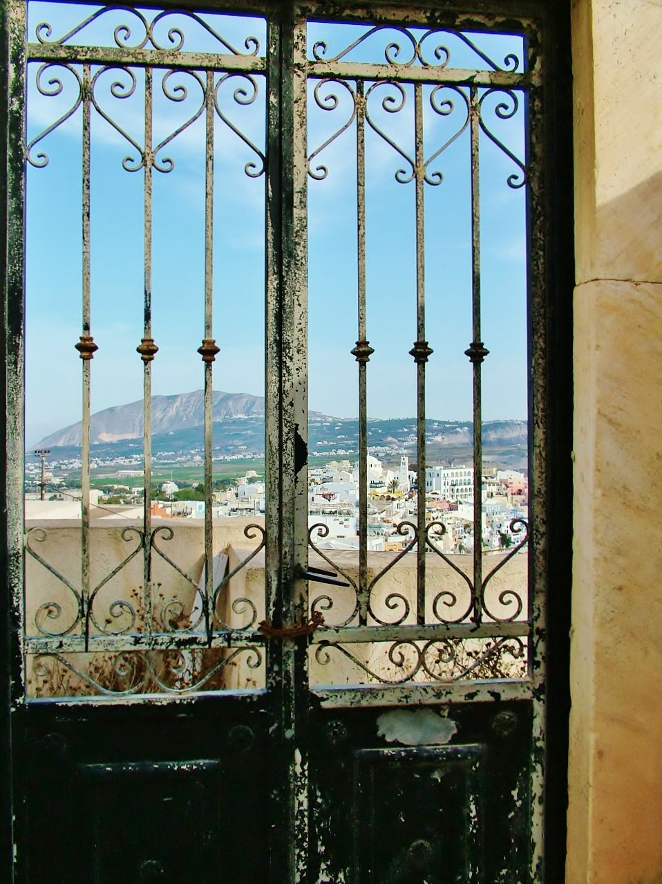 Beyond this weathered wrought iron door is a panoramic