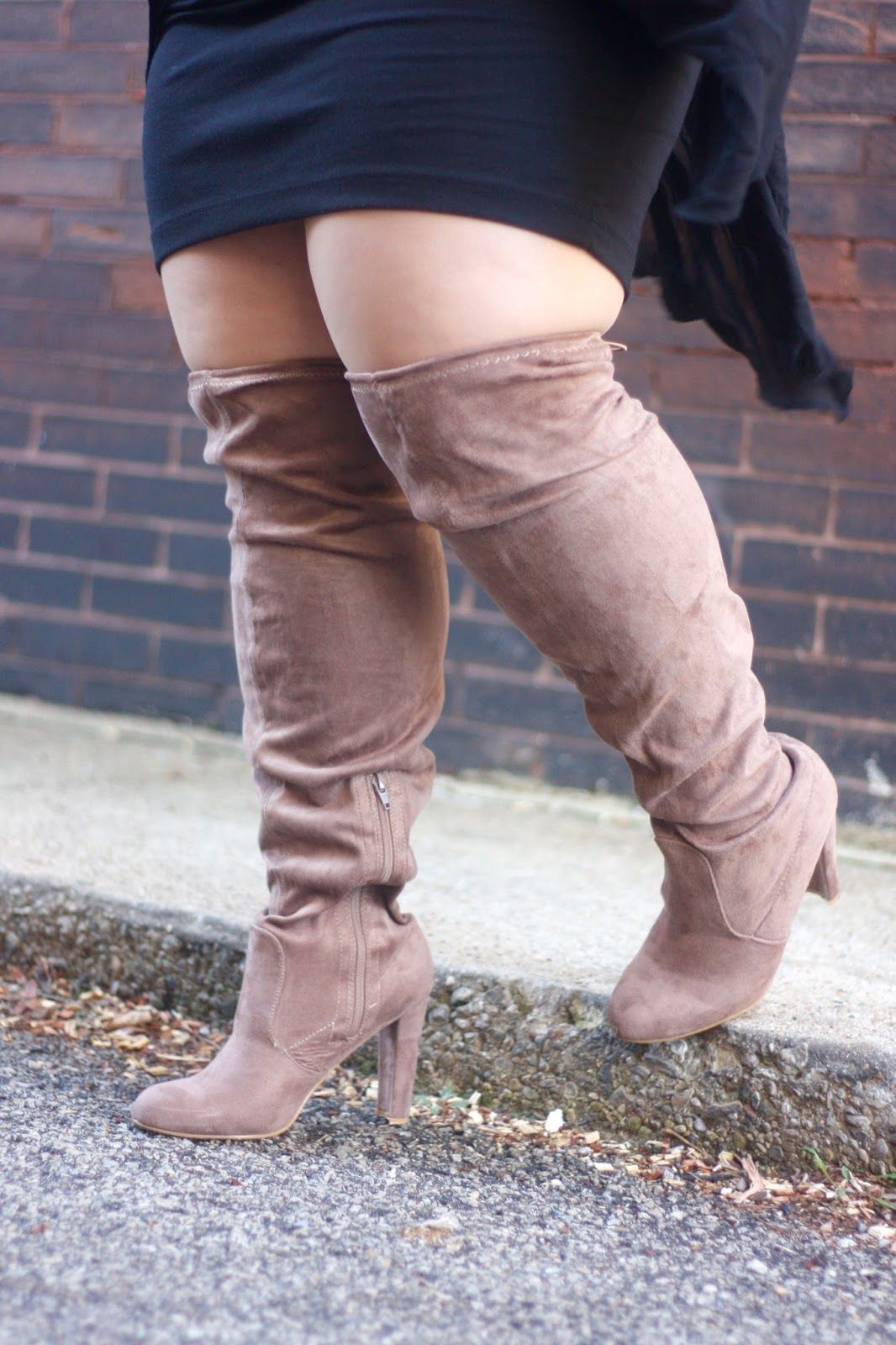 5311e0992d82 These thigh high boots from fashion to figure fit wide calfs and thighs,  perfect for a plus size fashionista. Check them out on NatalieintheCity.com!
