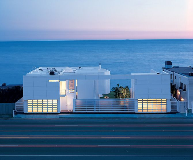 modern beach house with white exterior paint by richard meier - Beachfront Home Designs