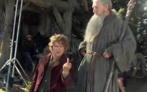 The I'm sick of being small next to Gandalf shot.   The 21 Most Glorious Photos Of Bilbo Baggins Giving The Finger the hobbit on set