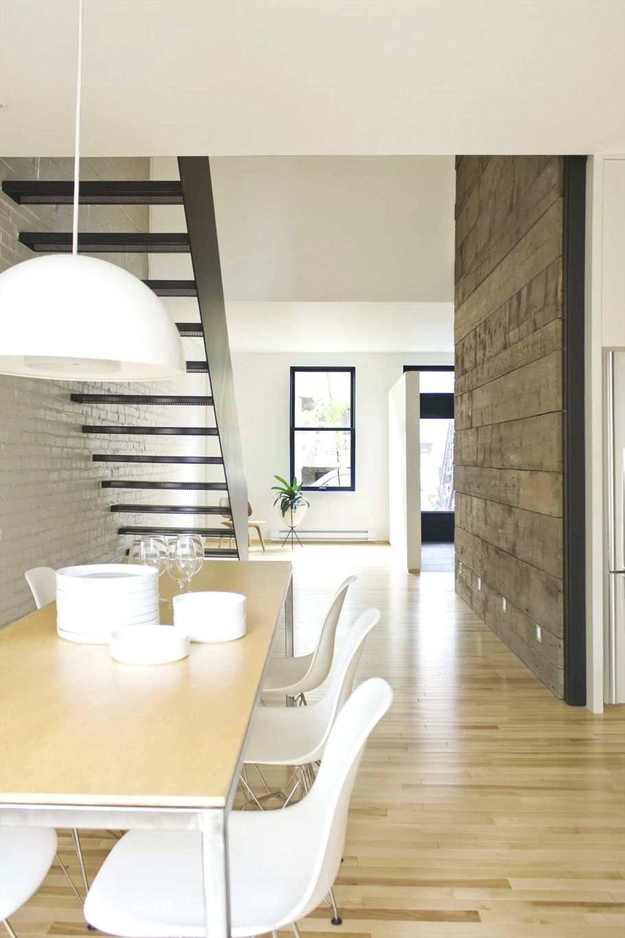 Wooden wall and great stairway against the brick feature wall ...