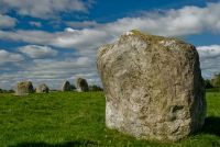"""Standing stone On a sloping hillside near Penrith, Cumbria, lies the 3rd largest stone circle in England (after Avebury and Stanton Drew). Long Meg and her Daughters is composed of a large ring (more an ellipse than a circle) measuring 300 x 360 feet, and several large outlying stones. The largest of these outliers is Long Meg, the """"mother stone"""""""